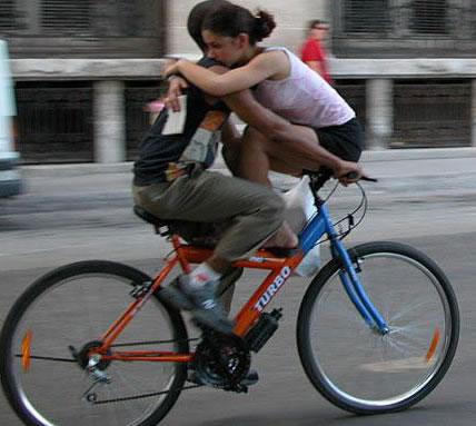 Bike Commuters, two to a bike