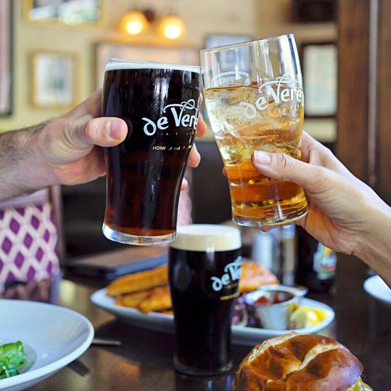 de Vere's Toasted Pints joined together in camaraderie